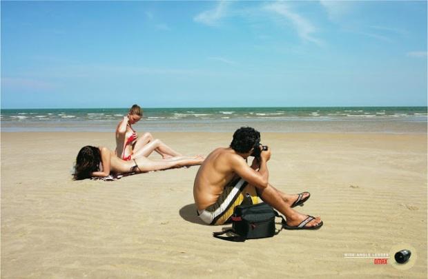 omax-ultra-wide-angle-lens-joke-parody-advertisment-commercia-sea-bikini-women