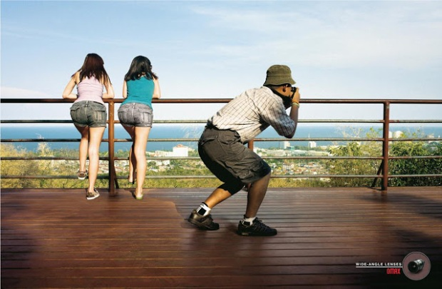 omax-ultra-wide-angle-lens-joke-parody-advertisment-commercial-city-railing-women-leaning